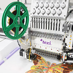 Embroidery machine, single-head, 15-needle with a base and the tooling of suspending sequins from a tape and sewing a cord